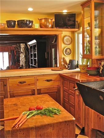 """Rustic Cabin Kitchen I built myself for peanuts, Deserted stone cottage that we had watched for 25 years and it finally came on the market. When we bought it it had only been used as a weekend get away but it is our full time home. We renovated on a shoestring and our kitchen is our pride and joy, all for under 5K, My husband found the soapstone sink in a barn where he had a studio. He spent many hours with wet sand paper smoothing the finish. The sink is huge, 48"""" wide but we have a food business and do a lot of cooking and fill the sink on a regular basis. Plus, when you have company you can dump dishes and they are out of sight!        , Kitchens Design"""