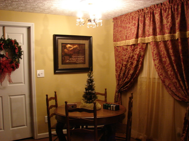 Western Saloon, Basement bedroom converted into a fancy Western Saloon with a Dining area., Antique table with ladder back chairs used as a poker table.  Custom curtains (made by me) to resemble an old western saloon.  Antique chandelier with medallion., Other Spaces Design