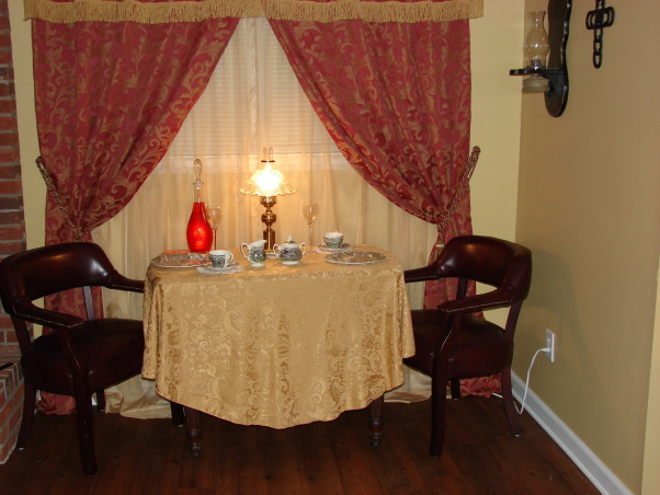 "Western Saloon, Basement bedroom converted into a fancy Western Saloon with a Dining area., Dining area with antique ""stagecoach"" china, leather chairs. Custom made curtains (by me)., Other Spaces Design"