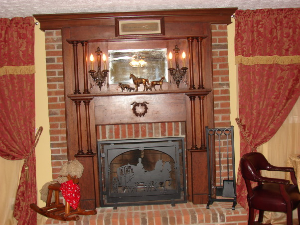 Western Saloon, Basement bedroom converted into a fancy Western Saloon with a Dining area., Antique fireplace surround taken out of 1800's home in Georgia.  Purchased sconces and had mounted, also killed brick from ceiling to top of surround with crown molding.  Firescreen was created from plasma cut metal with stagecoach scene which matches the stagecoach pattern on the china.  Antique rocking horse., Other Spaces Design