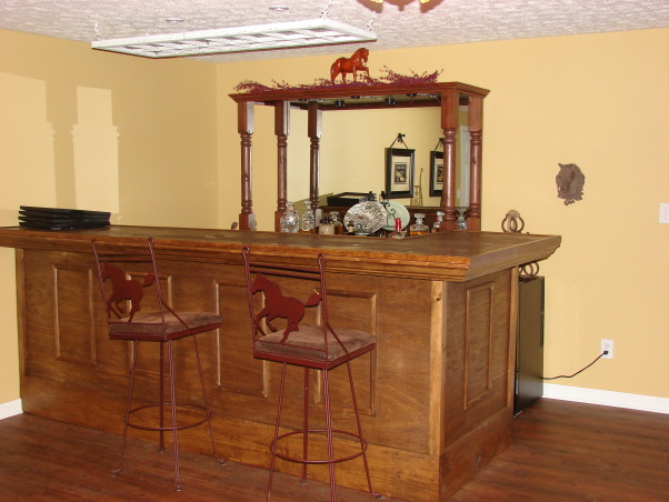 "Western Saloon, Basement bedroom converted into a fancy Western Saloon with a Dining area., Had the bar built - on top (didn't have enough room for more pics) it has cut outs for 10 arrowheads and our farm ""brand"" - also has cut outs with two horse shoes overlapping showing our farm ""Brand"" -- CC for Coldwater Creek., Other Spaces Design"