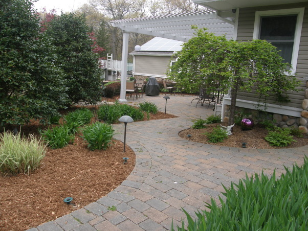 Mulch, mulch and more mulch!!!, Back yard patio., Under the pergola by the weeping cherry tree., Yards Design