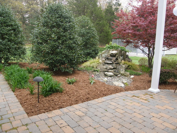 Mulch, mulch and more mulch!!!, Back yard patio., Holly trees are getting to be giants! Sorry waterfall isn't on in this picture., Yards Design