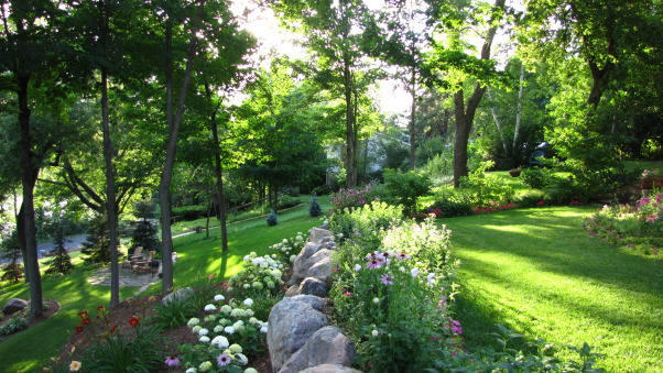 Summer's Reward, A one acre lot full of annual and perennial beds in minnesota, border and boulders         , Gardens Design