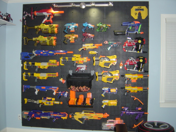 Ben's Nerf Paradise, We put crown molding and a shelf for my son Ben's Lego's but the focus of the room is a peg board wall for his Nerf gun collection., Boys' Rooms Design