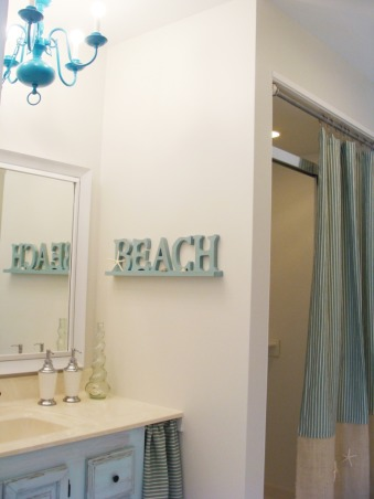 Beachy Guest Bath update under U$60!  :), When we first moved in, our guest bathroom was desperate for some TLC. Although we have big future plans for it, we decided to go with a quick update for now. This update was basically paint, repurposing things, sewing plus accesories. To read more, you can go here: http://www.whiteinspirations.com/guest-bathroom/guest-bath-update/, Notice the cheap chandelier painted turquoise.           , Bathrooms