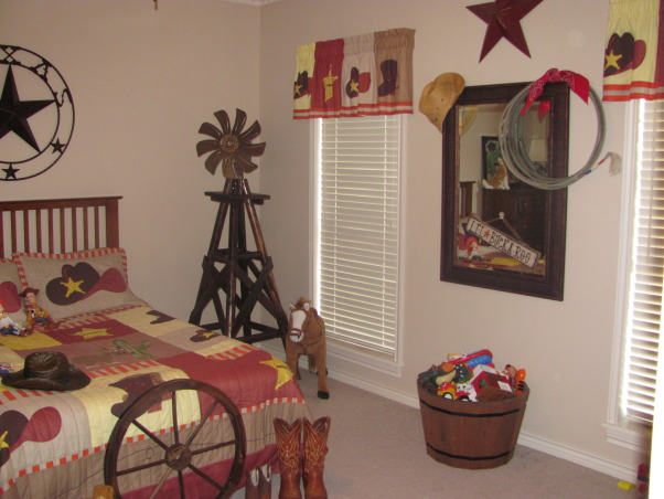 "Western, Texas, Ranch Room, This is my 3 year old grandson's room. My house has a western/southwestern decor therefore a little buckaroo room is perfect for him., I used a barrel planter to store his toys.  It matches the decor better than the average plastic toy box and it holds alot of toys. The mirror is also a left over from this room which use to be an exercise room. I didn't have a place to put it so I left it there and spruced it up with a cowboy hat, lariat, and a ""howdy"" sign. Red metal star above is from Hobby Lobby.      , Boys' Rooms Design"