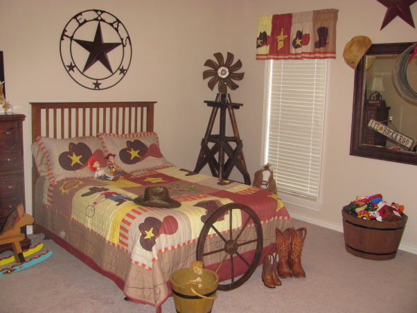 Western, Texas, Ranch Room, This is my 3 year old grandson's room. My house has a western/southwestern decor therefore a little buckaroo room is perfect for him., As a child I would wait for my parents to come home from work so they could take me to see the windmills along the ranch roads of South Texas. When I saw this beautiful and very sturdy wooden windmill I had to have it for my grandson's room. Our H.E.B. Texas Backyard is a great place to purchase western items such as the large TEXAS star above the bed.      , Boys' Rooms Design