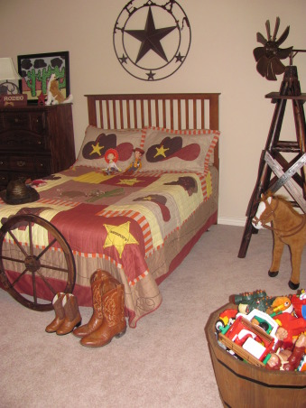 Western, Texas, Ranch Room, This is my 3 year old grandson's room. My house has a western/southwestern decor therefore a little buckaroo room is perfect for him., Grandpa's and grandson's boots decorate the foot of the bed along with a wagon wheel purchased at Big Lots. Cowboy bedding and valances were purchased online from Baby Super Mall.      , Boys' Rooms Design