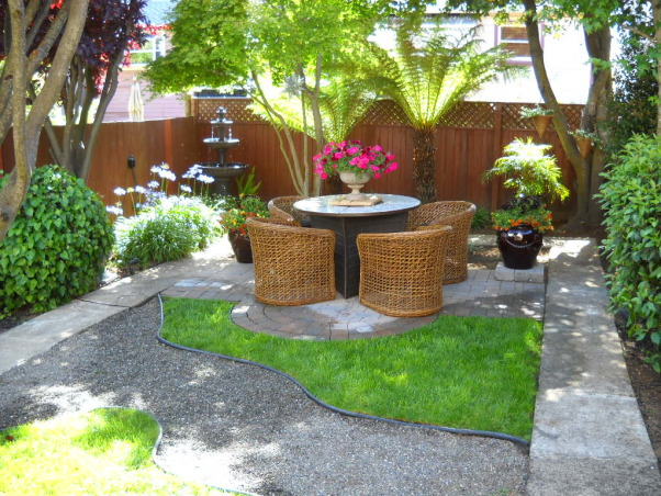 Change Is In The Air, Small City Garden.  I Love change. Simple changes produce big results!, All weather wicker chairs surround a firetable on the small rear patio , Gardens Design