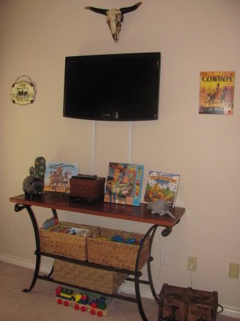 Western, Texas, Ranch Room, This is my 3 year old grandson's room. My house has a western/southwestern decor therefore a little buckaroo room is perfect for him., Wall mounted T.V. allows for other things to be placed on this table.  This was an odd sofa table that I placed in his room and added baskets below for toy storage.   , Boys' Rooms Design