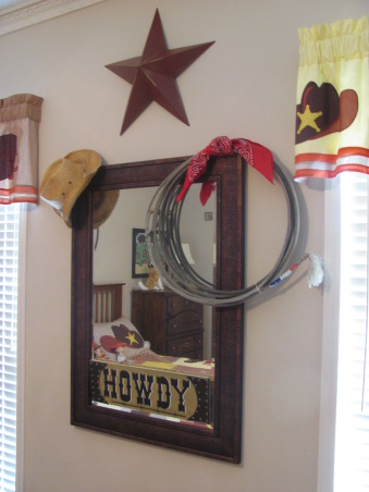 "Western, Texas, Ranch Room, This is my 3 year old grandson's room. My house has a western/southwestern decor therefore a little buckaroo room is perfect for him., Found a really cute ""howdy"" sign at Hobby Lobby. Cowboy hat and real used rodeo lariat hang on mirror.   , Boys' Rooms Design"