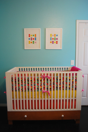 """Poppie's Candy Land Nursery, My daughter, Poppie Ainsley's room was inspired by the board game Candy Land.  We began the process by painting the room a great Tiffany blue color and then candy striped the ceiling pink, red and white (talk about a tough task at seven months pregnant!).  I then painted the Candy Land mural on one wall.  We kept the cost of the room low by using a floor model """"Toys R Us"""" Amy Coe Crib and Target Furniture.  Little accents like polka dotted knobs made the pieces look way more expensive than they actually were!  I painted a clearance mirror frame bright red and balanced the color of the room with the round, white rug.  Finally candy was placed in glass jars through out the room.  We love it!  I hope you do as well :), Nurseries Design"""