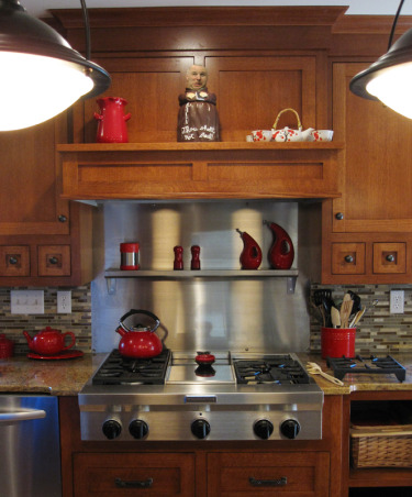 Craftsman kitchen remodel, Remodeled our builder grade kitchen into a craftsman, mission style kitchen. Granite countertops, quarter sawn oak cabinets  Backsplash is SomerTile Reflections Stone Subway Latte Wall Tiles from Overstock.com.  The Island pendants are Pendant No. 7602 by Savoy House from lumens.com  Cabinets are by a local custom cabinet maker. http://www.lustigcabinets.com/, Kitchens Design