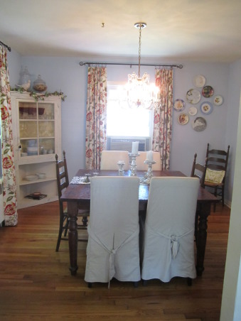 """My """"Blue"""" dining room, Bohemian dining room with traditional pieces and different color fabrics.  Large chalkboard to write the menu of the meal!  This is a 1930's cape cod house. Let me know your thoughts of this space!  *Please excuse the air conditioning unit in the dining room....we are about to get central air! :), My dining room       , Dining Rooms Design"""