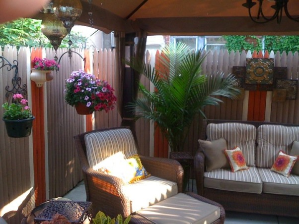 Small Inner City Patio, I live in downtown Philadelphia and wanted a cozy, fun and relaxing outdoor space...this is the result., I added some big green plants to add a sense of lushness. , Patios & Decks Design