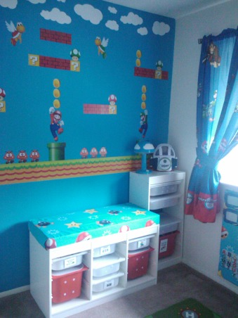Super Mario Room, For my sons fifth birthday I surprised him with a Super Mario themed bedroom.  He has a relatively small room, 11ft x 10ft, however I think it turned out ok.  He loves it...I think it is a little busy, but my design sense is usually minimalistic so that could be why.  My favorite part of his room is his newly organized closet, prior to the room makeover the majority of his toys were in the closet and the majority of his clothes were in the master closet, however now, with his new found freedom he is dressing himself without assistance (yeah).  His favorite part of the room is his new reading bench.  He still has a few toys in the room, however the majority of his toys are housed in the play area, I will post soon.  I am not a huge fan of TVs in children's rooms (however my 16 & 17 year olds both have them) but I did concede and provided him with a small portable DVD player for the occasional use.  Let me know what you think, I am still not sure if I love it., Accent Wall - this is my son's favorite spot, the cushion that I added to the top of his toy shelf created a nice little spot to read and relax  , Boys' Rooms Design