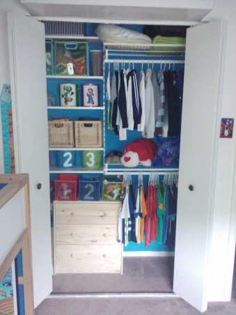 Super Mario Room, For my sons fifth birthday I surprised him with a Super Mario themed bedroom.  He has a relatively small room, 11ft x 10ft, however I think it turned out ok.  He loves it...I think it is a little busy, but my design sense is usually minimalistic so that could be why.  My favorite part of his room is his newly organized closet, prior to the room makeover the majority of his toys were in the closet and the majority of his clothes were in the master closet, however now, with his new found freedom he is dressing himself without assistance (yeah).  His favorite part of the room is his new reading bench.  He still has a few toys in the room, however the majority of his toys are housed in the play area, I will post soon.  I am not a huge fan of TVs in children's rooms (however my 16 & 17 year olds both have them) but I did concede and provided him with a small portable DVD player for the occasional use.  Let me know what you think, I am still not sure if I love it., Another view of the closet  , Boys' Rooms Design