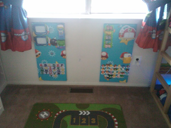 "Super Mario Room, For my sons fifth birthday I surprised him with a Super Mario themed bedroom.  He has a relatively small room, 11ft x 10ft, however I think it turned out ok.  He loves it...I think it is a little busy, but my design sense is usually minimalistic so that could be why.  My favorite part of his room is his newly organized closet, prior to the room makeover the majority of his toys were in the closet and the majority of his clothes were in the master closet, however now, with his new found freedom he is dressing himself without assistance (yeah).  His favorite part of the room is his new reading bench.  He still has a few toys in the room, however the majority of his toys are housed in the play area, I will post soon.  I am not a huge fan of TVs in children's rooms (however my 16 & 17 year olds both have them) but I did concede and provided him with a small portable DVD player for the occasional use.  Let me know what you think, I am still not sure if I love it., Two magentic boards I created for some of his ""refrigerator toys""  , Boys' Rooms Design"