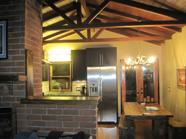 Before and after ...., this home was a complete fixer ! We really had to start with the kitchen. I love love my new kitchen. Its a small space and we really needed to make the most of it. We want from 1950's style to modern living. It's so easy to cook in, which we love to do :), We fall in love with the high ceilings in the house when we got this house and know we could work with it. We took this brick wall down half way to open up the room to the living area. We made it a bar and on the other side a small inland. It's just perfect for prepping meals and still able to watch TV or visit with your guest  , Kitchens