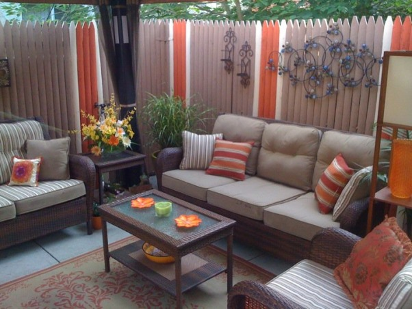 "Small Inner City Patio, I live in downtown Philadelphia and wanted a cozy, fun and relaxing outdoor space...this is the result., I painted the fence ""Ice Tea"", ""Glowing Firelight"" and ""Apple Crunch"". The colors and pattern were inspired by the pillows in this picture. , Patios & Decks Design"