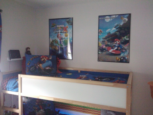 Super Mario Room, For my sons fifth birthday I surprised him with a Super Mario themed bedroom.  He has a relatively small room, 11ft x 10ft, however I think it turned out ok.  He loves it...I think it is a little busy, but my design sense is usually minimalistic so that could be why.  My favorite part of his room is his newly organized closet, prior to the room makeover the majority of his toys were in the closet and the majority of his clothes were in the master closet, however now, with his new found freedom he is dressing himself without assistance (yeah).  His favorite part of the room is his new reading bench.  He still has a few toys in the room, however the majority of his toys are housed in the play area, I will post soon.  I am not a huge fan of TVs in children's rooms (however my 16 & 17 year olds both have them) but I did concede and provided him with a small portable DVD player for the occasional use.  Let me know what you think, I am still not sure if I love it., My son's bed  , Boys' Rooms Design