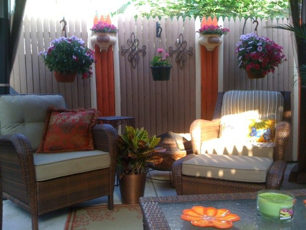Small Inner City Patio, I live in downtown Philadelphia and wanted a cozy, fun and relaxing outdoor space...this is the result., The plant sconces were like $5 from Home Goods which I then painted the same colors as the fence. , Patios & Decks Design