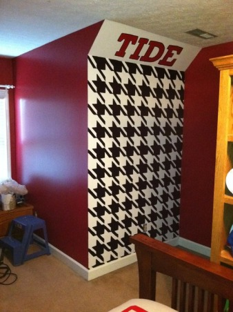 """Roll Tide Relaxation"", Wall paintings for an Alabama Football themed bedroom for a 7th grade boy., Hand painted Houndstooth print on the two 5' x 8' walls that flank the doghouse widow with 12'' tall ""Roll Tide"" above. , Boys' Rooms Design"