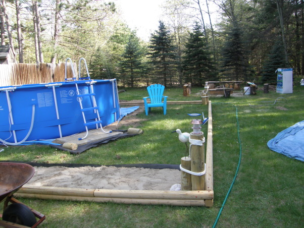 backyard beach, Backyard beach in the works please give me some ideas on putting in a tiki Bar somewhere on my beach I want something that will really be a wow to people. I want to do it by the fance maybe even painting on the fance... help me any ideas..., oh boy its going to take alot of sand to fill this sandboxs      , Yards Design