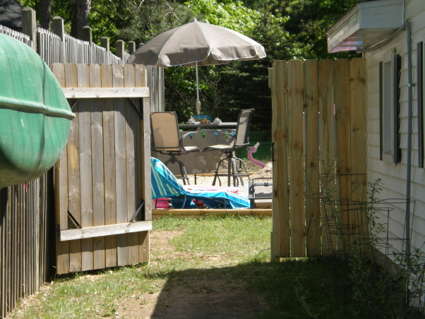 backyard beach, Backyard beach in the works please give me some ideas on putting in a tiki Bar somewhere on my beach I want something that will really be a wow to people. I want to do it by the fance maybe even painting on the fance... help me any ideas..., put in a gate , Yards Design