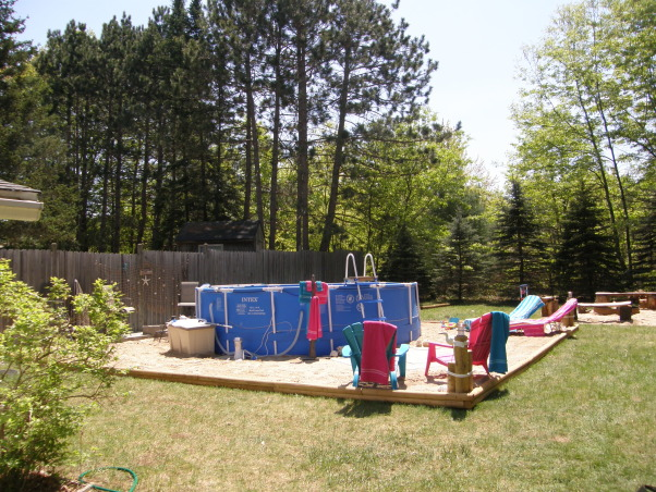 backyard beach, Backyard beach in the works please give me some ideas on putting in a tiki Bar somewhere on my beach I want something that will really be a wow to people. I want to do it by the fance maybe even painting on the fance... help me any ideas..., its starting to look like a beach      , Yards Design