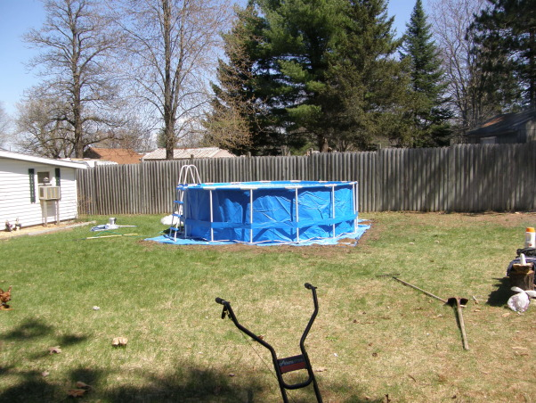 backyard beach, Backyard beach in the works please give me some ideas on putting in a tiki Bar somewhere on my beach I want something that will really be a wow to people. I want to do it by the fance maybe even painting on the fance... help me any ideas..., the pools up       , Yards Design