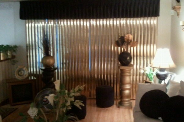 Egyptian Style , The Living room is one of our best stop in the house. We spray painted different sculptures and pillars to make a egyptian style look. , Egyptian sculptures & gold blinds that provided a black and gold finish. , Living Rooms Design