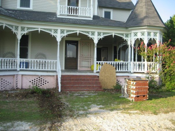 Victorian farmhouse renovation, SC circa 1900 Victorian style farmhouse was completely renovated.  , Many of the porch spindles were rotten and the steps had one rickety handrail.  New spindles had to be made and we made new handrails that curved outward at the bottom. , Home Exterior Design