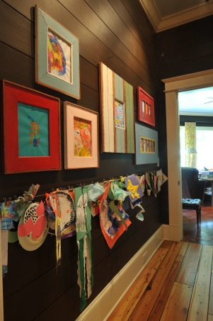 Kids' Art Center, Art central in my house for 4 kids under 5: chalkboard, a place to hang the kids' art by binder clips, frame more of their art, magnet board and a corkboard, from many saved corks, to hold invitations., Other Spaces Design