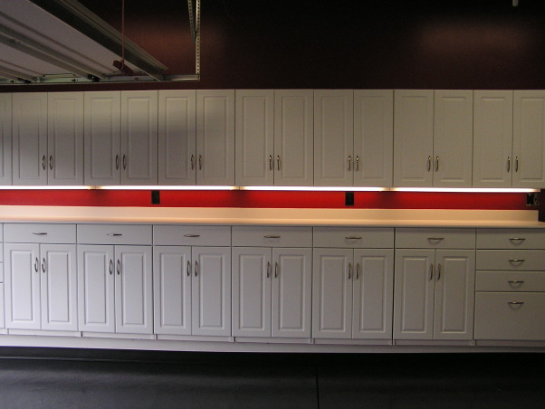 Is that a Garage or a Corvette Shop?, Check out the lights under the cabinets!   , Garages Design