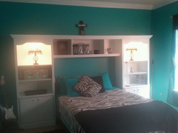 Classic Zebra, Teal and Black Zebra print teen room. Teenage girls need a place to relax and call their own. Make-up Vanity, chalkboard wall, white furniture, desk, She has her own hallway with a touch of pink, a Black Chandelier and Walk-in-Closet. You could do damask in place of the Zebra theme. , This wall unit was built by my husband~We bought the bookshelves on Craigslist two for $30.00 We sanded them took the handles off and painted them white with a sprayer. He tore the back off and added Wainscoting to the back of them to make them look nicer We tore the top trim off and then used plywood to make the center shelves. We added trim to the front and Crown molding on the top and then repainted the top white. We then added lights in the top and ran a switch down to where she could turn it off and on while in bed.  , Girls' Rooms Design