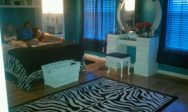 Classic Zebra, Teal and Black Zebra print teen room. Teenage girls need a place to relax and call their own. Make-up Vanity, chalkboard wall, white furniture, desk, She has her own hallway with a touch of pink, a Black Chandelier and Walk-in-Closet. You could do damask in place of the Zebra theme. , Bought the vanity off of Craigslist for $35.00 and the stool at a garage sale for $5.00 and put vinyl on the seat. We sanded and refinished the vanity and my husband made it taller and added the lights on the back with a switch on the side. I also got the zebra rug for $40.00 off of Craigslist.  , Girls' Rooms Design