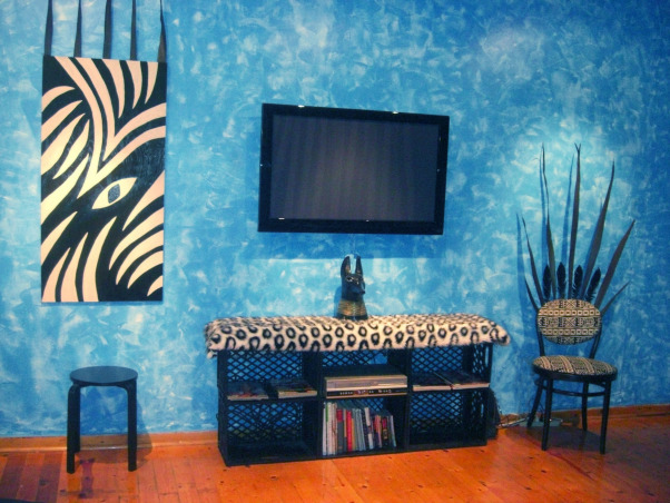 Modern Blue in Black and White, Before and after my living room space makeover. I wanted something Bold and Extreme! Everything in black and white only! No color except the tropic blue textured walls. I intended the room to look surreal and fantasy-like. Enjoy!, South view of room with plasma TV and entertainment area.      , Living Rooms Design