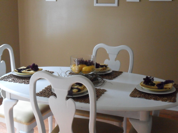 Yellow and Purple Dining Room, Neutral room with yellow and purple accents. White furniture was used as the canvas. , I bought this table for $75.00 at a local thrift shop, sanded, and painted it white. , Dining Rooms Design