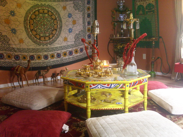 Hookah Lounge, Welcome to my Favorite room in my house,this room is very colorful featuring a Beautiful Egyptian canopy that covers all the ceiling,large floor pillows,persian rug,egyptian lanterns,my collection of hookahs,gold tone tea set,candles,middle eastern tapestry,gold draperies,colorful coffe table with hand painted designs,this room is relaxing., This table was painted by me using stencils. , Media Rooms Design