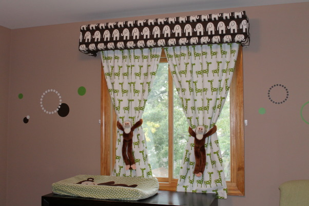 Twin Nursery for Boy and Girl, Fun gender neutral modern space for boy / girl twins, My mom and I made the curtains and cornice.  The fabric is from FabricGuru.com and got the monkeys at the zoo!  I have small hooks to the side of the windows for them to hang on when I want to close the curtains., Nurseries Design