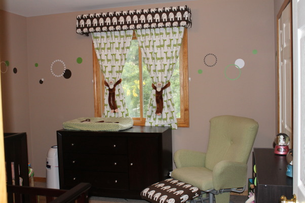 Twin Nursery for Boy and Girl, Fun gender neutral modern space for boy / girl twins, We had the glider from my older daughter and the ottoman was given a new life with the matching elephant fabric., Nurseries Design