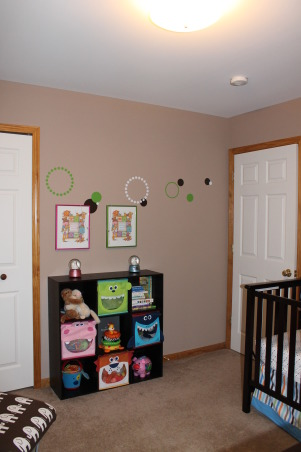 Twin Nursery for Boy and Girl, Fun gender neutral modern space for boy / girl twins, Toy / Bookshelf from Target and LOVE the animal cubes. Above in the frames are cross stich that my sister made with their names and birth stats., Nurseries Design