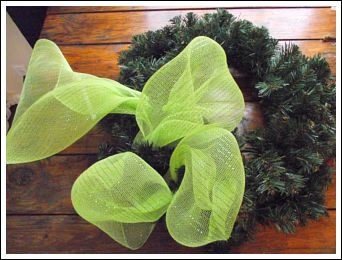 Christmas Mesh Wreath!, I love mesh ribbon!  It is so durable and easy to use.  This was a really fun wreath to make! For more detailed instructions, and other Christmas decorating ideas visit http://www.decorating-ideas-made-easy.com/how-to-make-a-wreath.html, Here I attached the mesh ribbon by twisting one of the wired branches tightly around the ribbon.  No glue- love it!  The secret to making this wreath is keeping your loops all the same size., Holidays Design