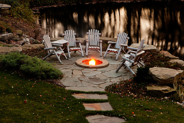 Natural Landscape, This was a landscape that I designed to meet the homeowner's specific desire to have the new landscape blend with the surrounding woods around the residence. , This is a flagstone patio with a firepit we built over the lake on the back of the property. , Yards Design