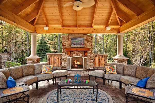 Outdoor living space, Pool cabana combined with fireplace for multi-seasonal use.  Floor is stamped concrete that looks like planks., Gazebo/Pool Pavilion., Patios & Decks Design