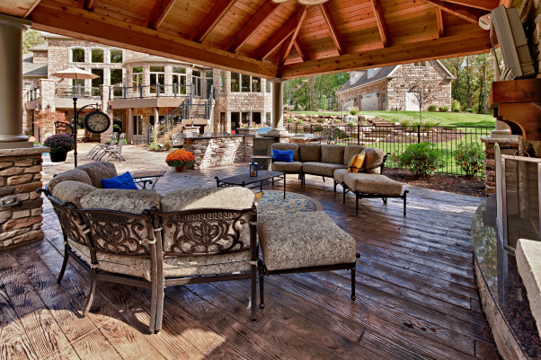 Outdoor living space, Pool cabana combined with fireplace for multi-seasonal use.  Floor is stamped concrete that looks like planks., Patios & Decks Design