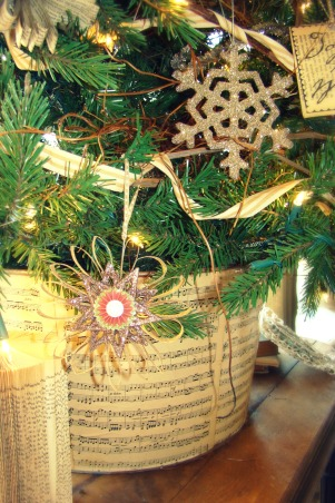 "Christ in the center of our Christmas!, Christmas in the Bungalow ~ incorporating pages of old books and sheet music, vintage shiny brite ornaments, and ""wrapping"" our home in God's word!, I recovered the galvanized tin bucket in sheet music simply using ""Modge Podge"".   , Holidays Design"
