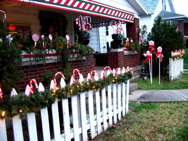 Sweet Christmas 2011, My outdoor Christmas decorating this year took a sweet turn.  Inspired by candy canes, peppermints and lollipops, I couldn't be happier with the results.  A lot of the decorations were handmade and handpainted.  I hope you enjoy!!  Merry Christmas , The front of our home that was built in 1942 decked out in it's Candy Cane finery. , Holidays Design